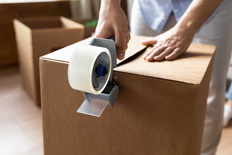 Man uses OPP tape to seal box